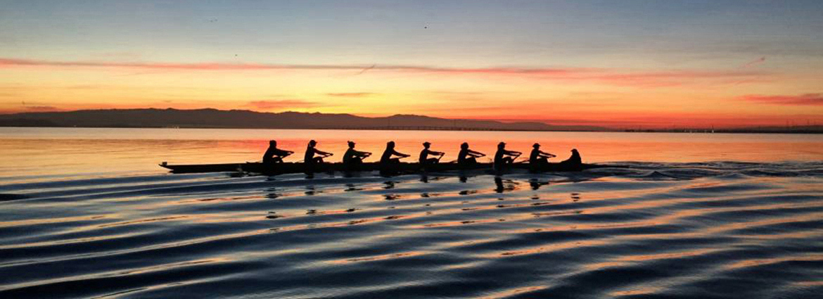 Stanford women's crew team on the water at sunrise